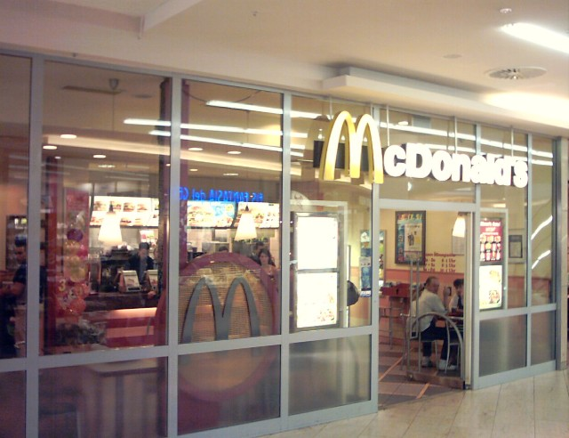 a McDonald's fast food restaurant behind glass windows