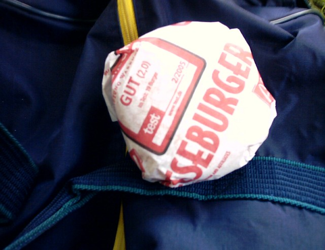 a McDonald's cheesburger still in its wrapping