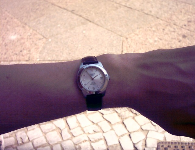 a wristwatch at five minutes to two o'clock