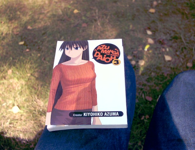 the cover of the Azumanga Daioh manga volume 3 showing a girl with long dark hair in a yellow and red pullover