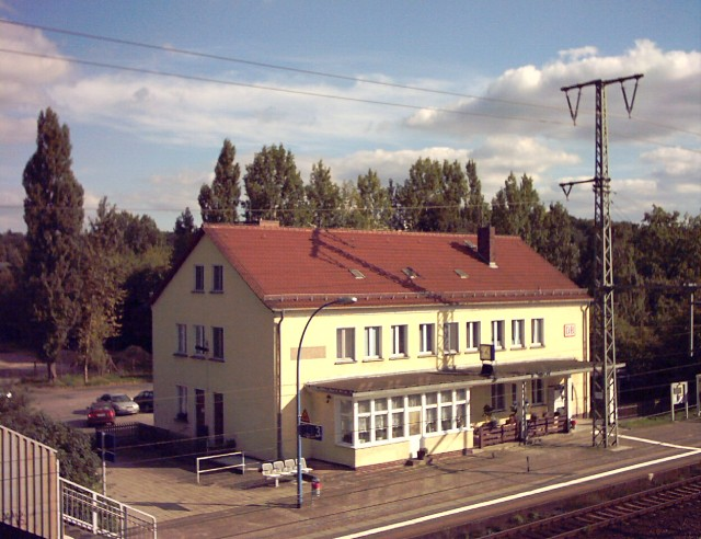 a railway station building with gable end roof