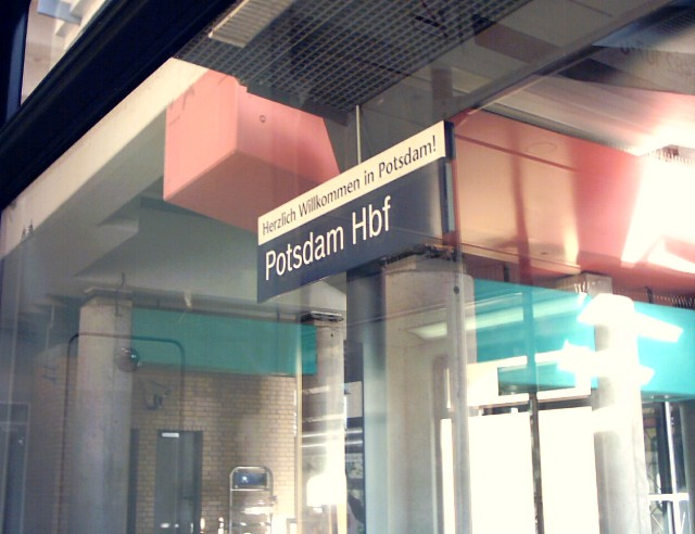"a sign at Potsdam's main train station; above ""Potsdam Hbf"" it says ""Herzlich Willkommen in Potsdam!"""
